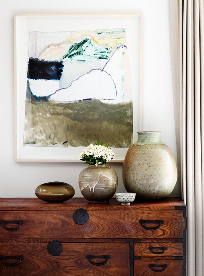 The zen theme continues in the main bedroom, with this 300-year-old Oriental chest bought by the owners in Japan, and earthy vases from Planet. Artwork by Sally Anderson from Small Spaces.