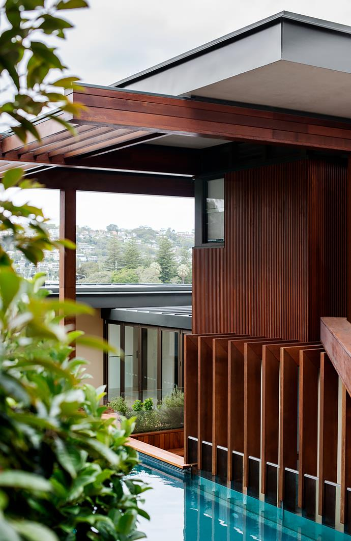 The timber batten motif is repeated throughout, both horizontally and vertically and as screening and cladding.