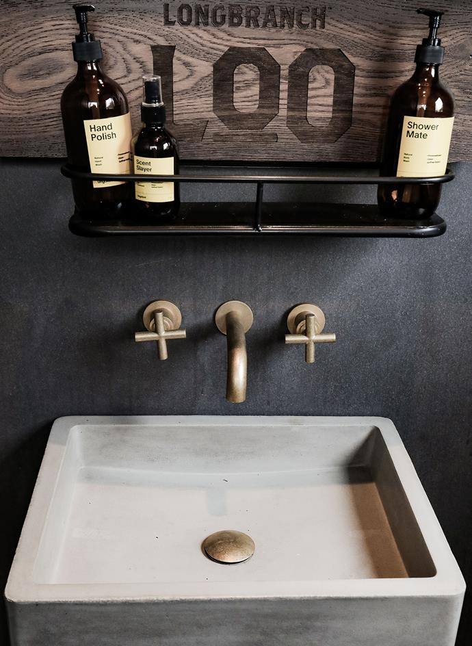 A wooden plaque is proudly hung in the bathroom door etched with the word's 'Longbranch Loo', aptly named after McConaughey's own Wild Turkey bourbon blend.