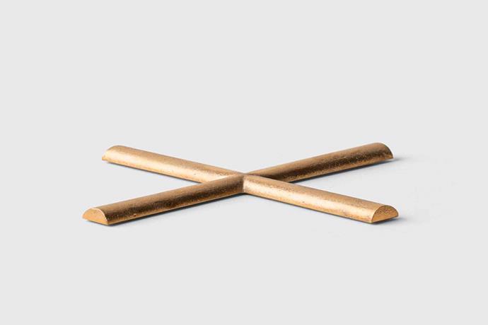 "S/N brass trivet, $75 USD, [Marie Kondo](https://shop.konmari.com/collections/cooking-kitchen/products/konmari-table-s-n-brass-trivet target=""_blank"" rel=""nofollow"")."