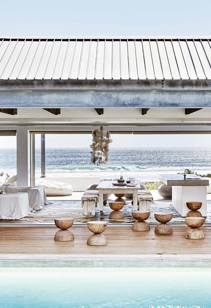 """It's this view that Cape Town couple Caroline and Manie Maritz chose to prioritise when building their remote [holiday home](https://www.homestolove.com.au/beach-house-south-africa-20848