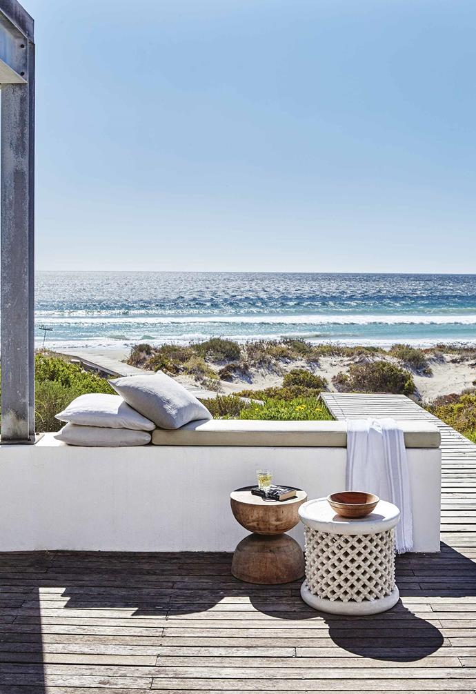 Other clever touches create memorable experiences. The fireplace, clad with sandstone bricks from Table Mountain, roars on wintery days, and it's where everyone gathers after rambling walks on the beach.<br><br>**Deck** Panoramic ocean views can be enjoyed from comfortable spots around the deck.