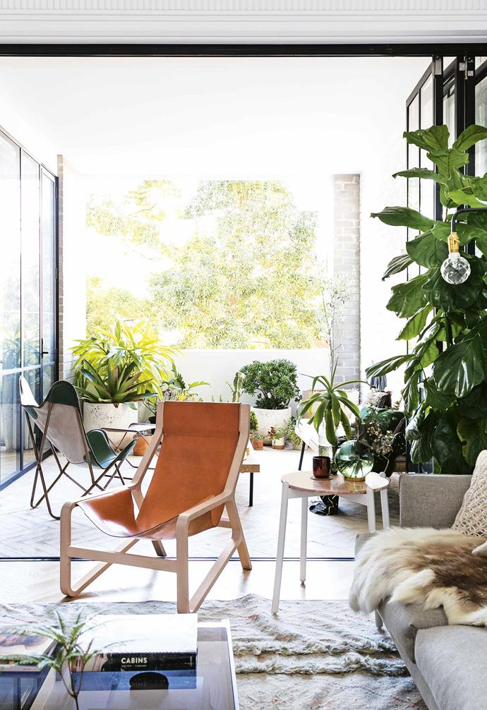"**What's your advice on setting up a small space?** <br><br>I've tried to stick to essential furniture only. Everything in the apartment has to have a reason to be there. I also chose an [oval dining table](https://www.homestolove.com.au/round-dining-room-table-design-ideas-19998|target=""_blank"") to create an easy traffic flow through the room. Most of the decor objects are props I use regularly for work so they're all on high rotation!<br><br>**Outdoor area** A mix of succulents and tropical plants feature on the balcony. ""They were mainly chosen because they're low maintenance and grow well in a sunny position,"" says Jono. ""The olive tree from [Garden Life](https://gardenlife.com.au/
