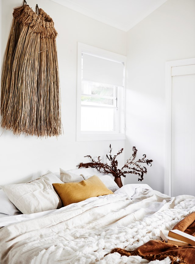 "Who said an all-[white bedroom](https://www.homestolove.com.au/white-and-neutral-bedroom-ideas-21321|target=""_blank"") can't feel warm and cosy? A wall hanging in from [Barefoot Gypsy](https://barefootgypsy.com.au/