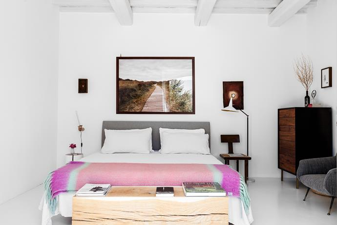 Doris filled her bedroom with pieces by her most-loved design brands, including the Zanotta 'Talamo' bed and white Gervasoni 'Log' side table. The chest of drawers is from Cargo & Hightech and the photographic print above her bed is by Valentino Fialdini.
