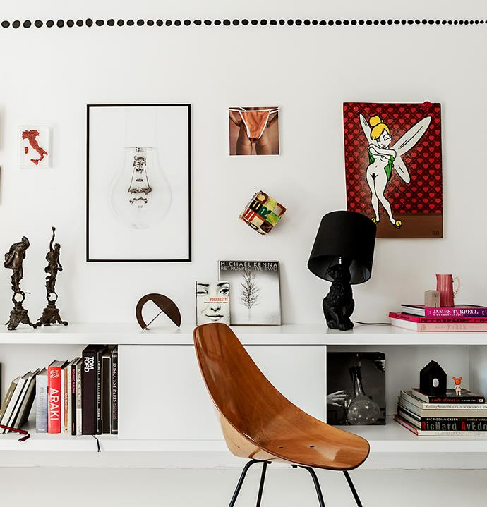 "An [art gallery wall](https://www.homestolove.com.au/how-to-create-an-art-gallery-wall-4860|target=""_blank"") in the living room juxtaposes 19th century bronze sculptures with Tinkerbell graffiti by Brazilian artist Ozi and a Moooi 'Rabbit' lamp. ""I always choose art that touches my heart. I need to have a connection,"" says  Doris. This Vittorio Nobili 'Medea' chair is her favourite furniture piece."