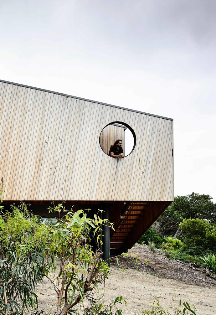 "**Exterior** The house is perched on a steeply sloped site with [timber cladding](https://www.homestolove.com.au/exterior-cladding-options-20504|target=""_blank"") that helps it blend into its natural surrounds."