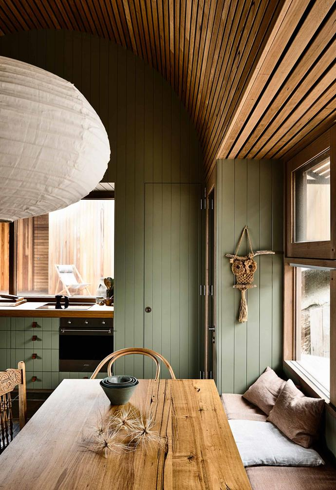 "**Kitchen and dining** [Internal weatherboard cladding](https://www.homestolove.com.au/interior-wall-cladding-20201|target=""_blank"") was given a coat of green paint with the vertical grooves creating a dynamic contrast to the timber batten ceiling."