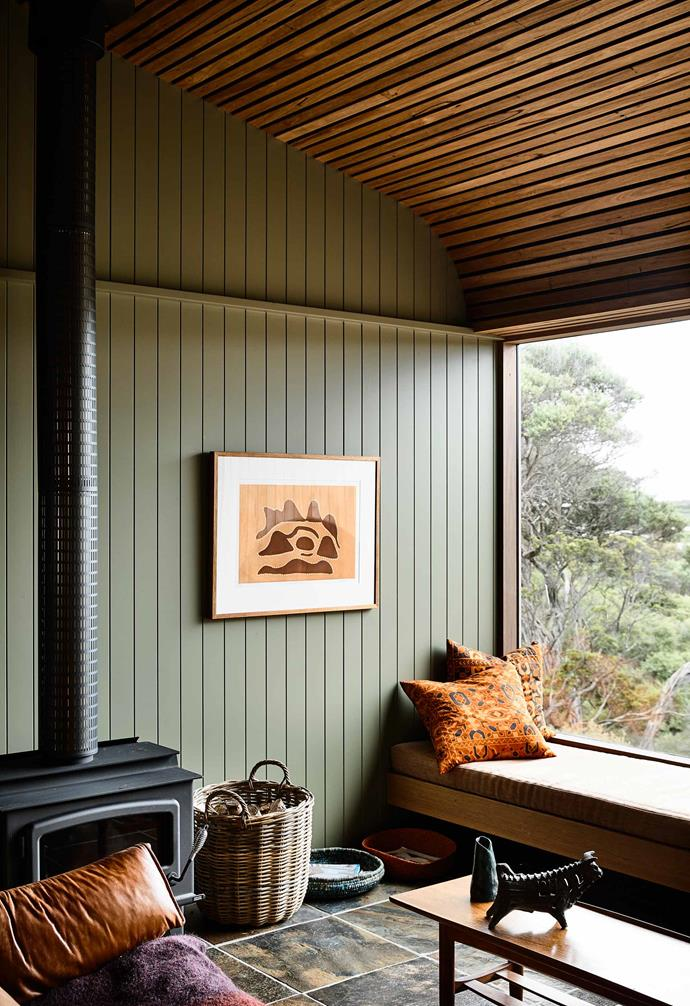 **Living area** A woodburning heater helps to keep the holiday house warm throughout the winter.