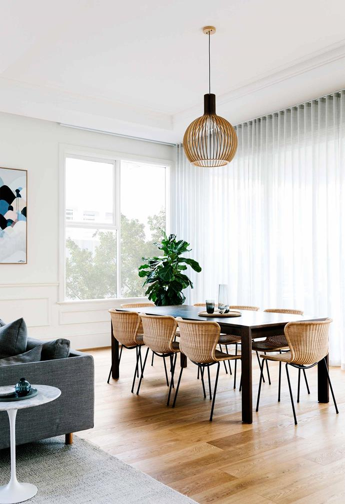 "**Dining area** Airy, inviting and a great spot to admire the home's coffered ceilings, the open-plan dining area benefits from the visual lightness of rattan dining chairs from [Open Room](https://www.openroom.com.au/|target=""_blank""