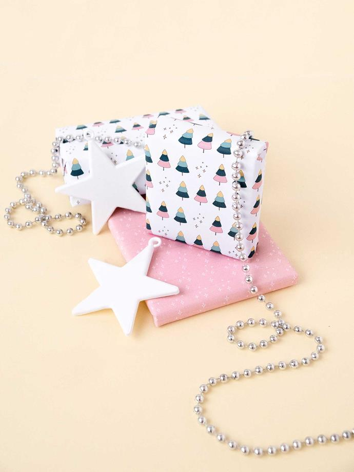 "**Pretty pink trees** - Put a playful spin on your Christmas wrapping this year with this pretty Christmas tree-printed paper by [Make and Tell](https://makeandtell.com/wp-content/uploads/2018/12/trees-and-stars-gift-wrap-printable.pdf|target=""_blank""