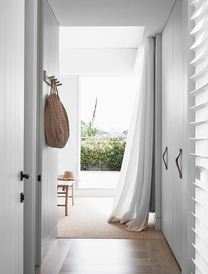 Entry to one of the bedroom suites continues the theme of pure white with tactile accents. European oak floorboards.