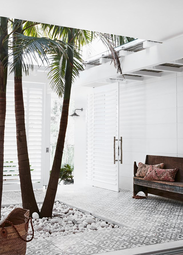 "Floor tiles from Jatana Interiors pave the breezy, open-air courtyard in this [waterfront home with a Bahamas-inspired aesthetic](https://www.homestolove.com.au/waterfront-abode-with-a-bahamas-inspired-aesthetic-20907|target=""_blank""), where palm trees take centre stage."