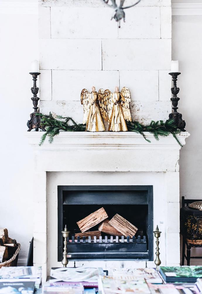 A mantel primed with fir-tree foliage.