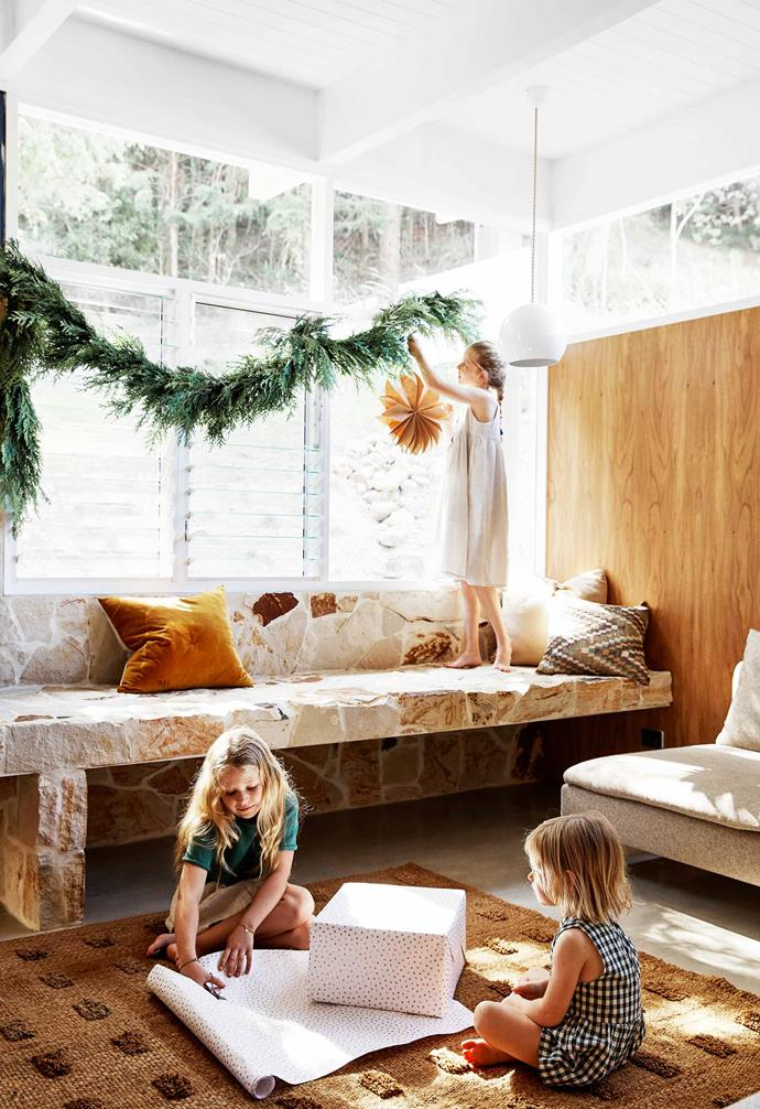 "**Living room** ""We love the slower pace of life here,"" says Megan as her daughters work on the decorations. Fresh conifer garland, [Braer](https://braerstudio.com/