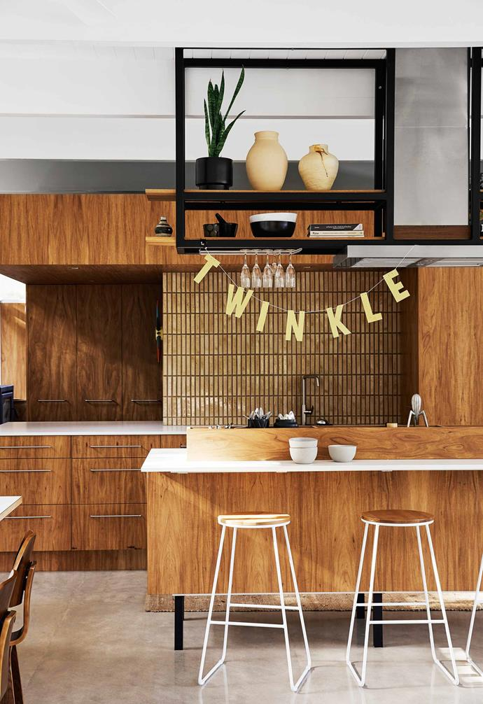 "**Kitchen** Organic textures in the Australian blackwood joinery and Iri finger mosaic splashback combine in effortless style. The floor is compressed concrete cement sheeting. ""It sits on top of the floor beams and we had it polished,"" says Megan. ""So, in a way it is the structure of the house."" [Quantum Quartz](https://www.wk.com.au/
