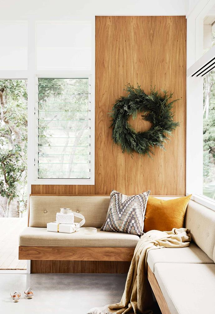 "**Sitting area** Louvre windows ensure the flow of fresh air throughout the home. Green conifer wreath, [Braer](https://braerstudio.com/|target=""_blank""