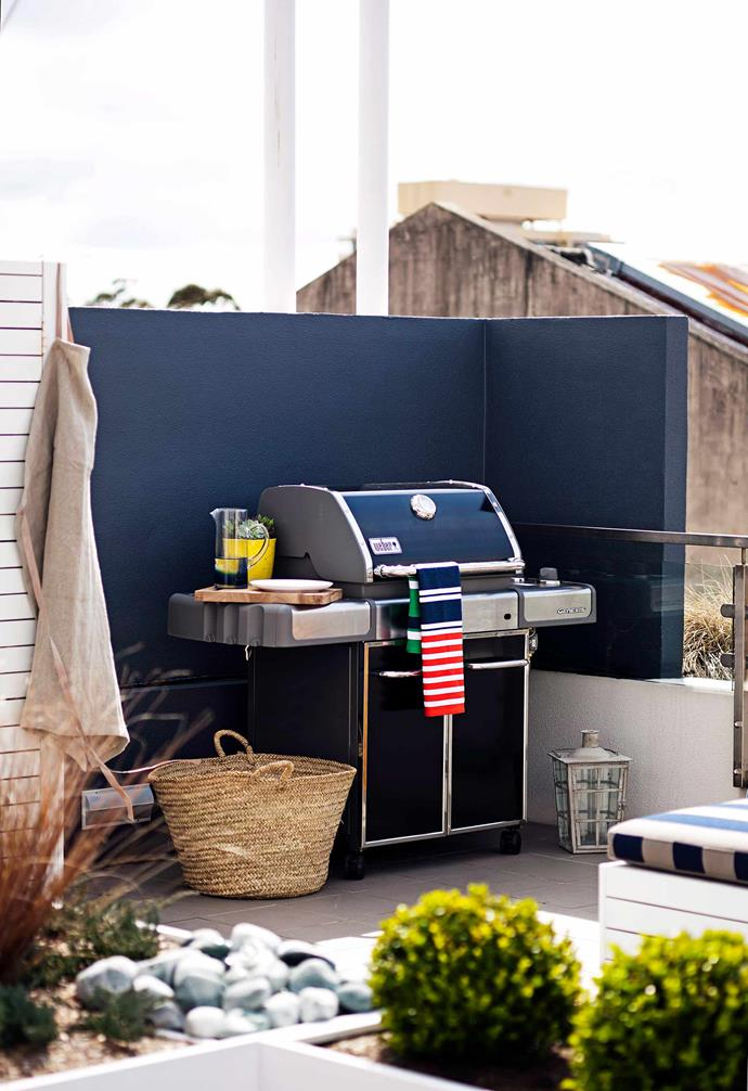 A sturdy freestanding barbecue provides all the practicality of an outdoor kitchen, without taking up too much space.