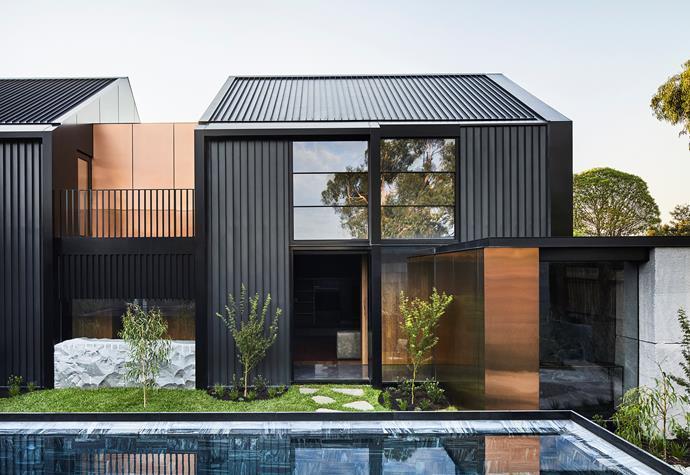 Black steel cladding creates a striking exterior.