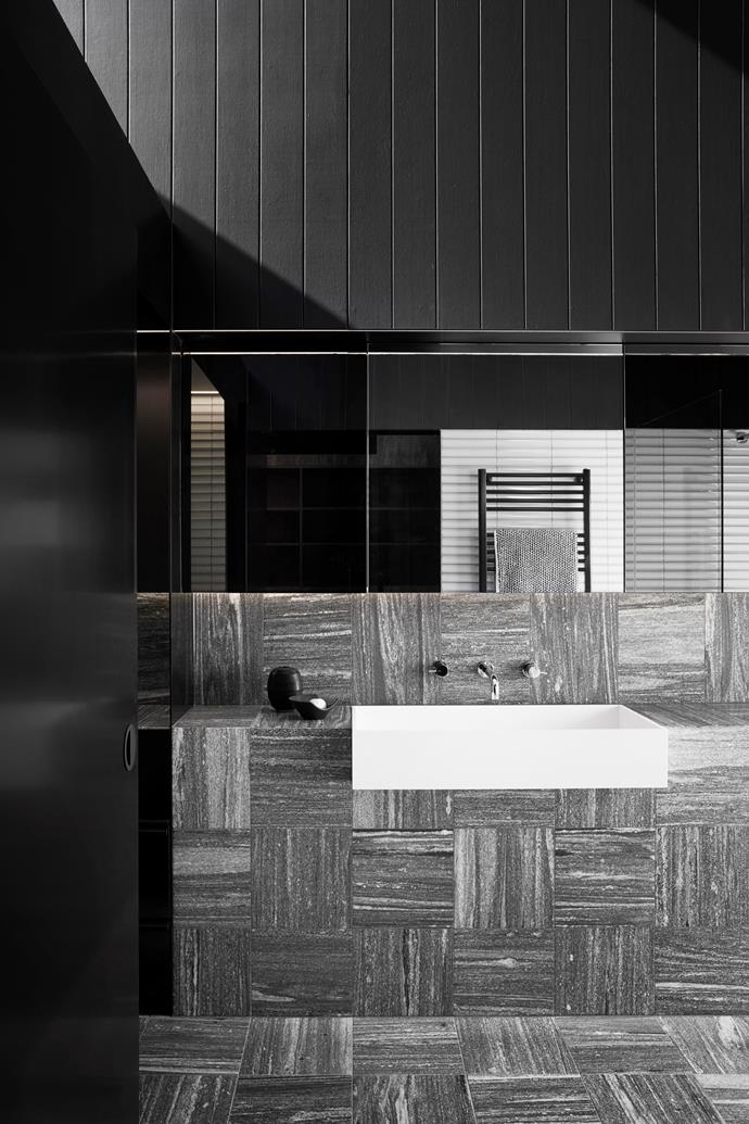 A variety of textures and materials creates visual interest in the monochrome bathroom.