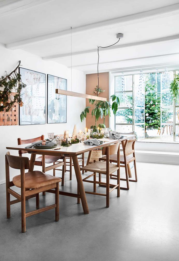 **Dining room** What was a disused basement has become a second eating area with adjacent conservatory. An Ilva table, Børge Mogensen chairs, Anour suspension light and exhibition posters ramp up the vintage chic.