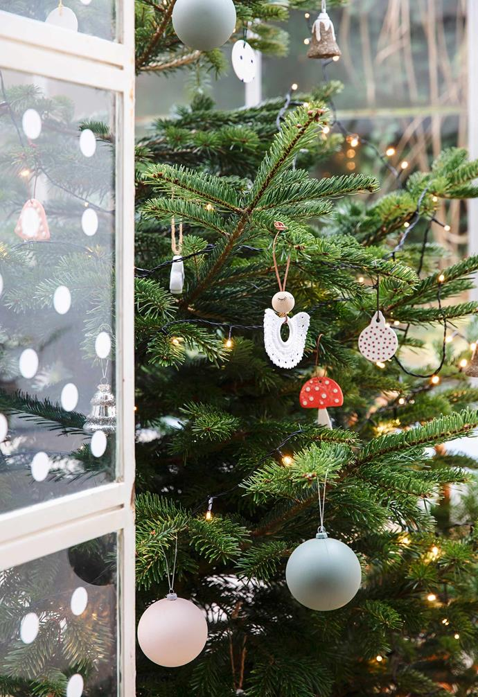 **Conservatory** Rikke ensured the Christmas tree was in a spot clearly visible from the dining table. When it comes to your feature tree, balance is key. A mix of shapes, materials and patterns brings interest, says Rikke, who chose ceramic ornaments and baubles in soft tones this year.
