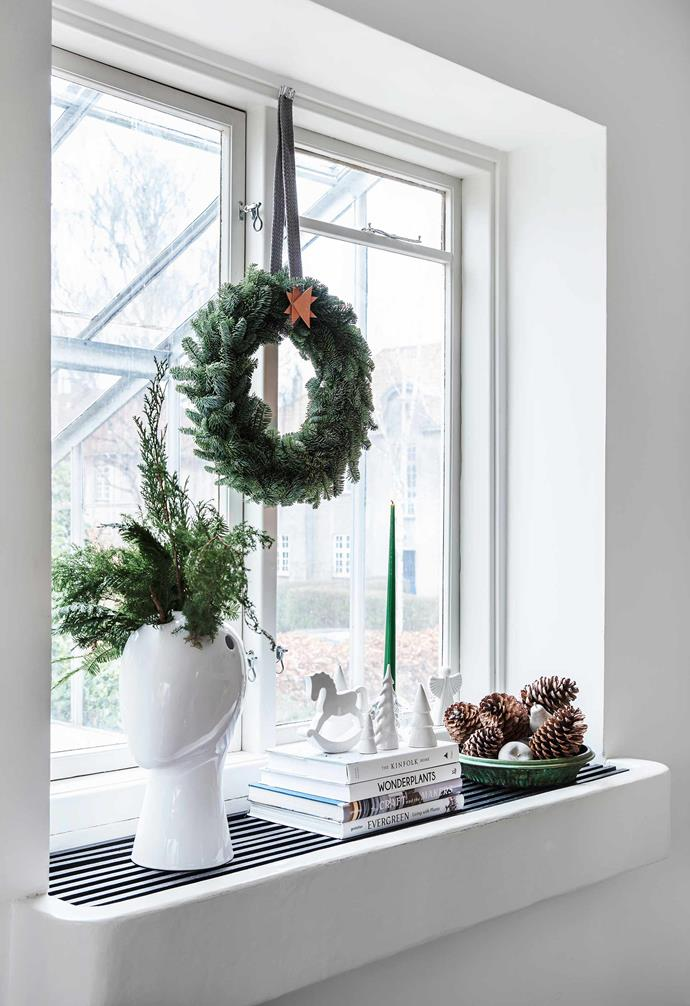 **DIY small wreath** If you're not crafty like Rikke, consider adding your own small personal touch to a store-bought wreath. This can be as simple as a bespoke leather strap or beautiful ribbon so the wreath can be hung at a window. Complete the look with a leather or fabric star created from four triangles grouped and glued together at different angles.