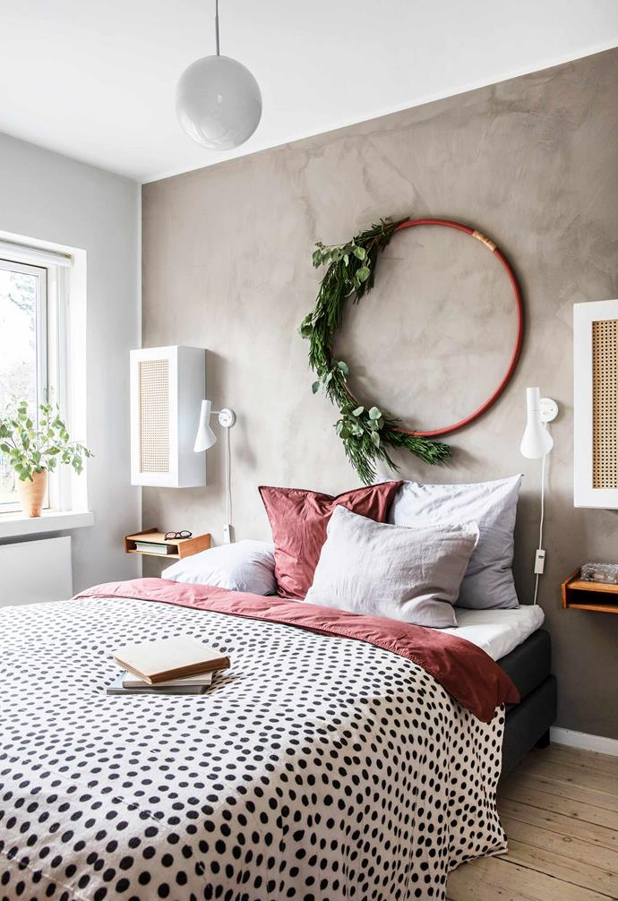 **Main bedroom** Rikke updated the cabinets with wicker panels. If you've conquered the smaller wreaths, this larger wreath will be a cinch. Spray-paint a larger hoop, then secure and layer eucalyptus and spruce twigs with floral wire to one section. Attach ribbon to hang.