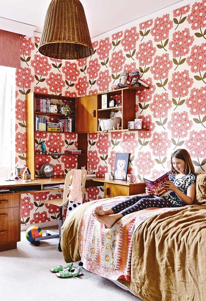 **How would you describe your aesthetic?** <br><br>It's fairly eclectic; I like mixing old and new things. I don't really look at interiors magazines or blogs for inspiration – I'd much rather do my own thing. I love collecting art, vintage furniture and pottery.  <br><br>**Billee's bedroom** Orla Kiely's 'Giant Rhododendron' wallpaper makes a bold impression. The timber shelf and desk came with the house, though Katie and Jason had it sanded and restained.