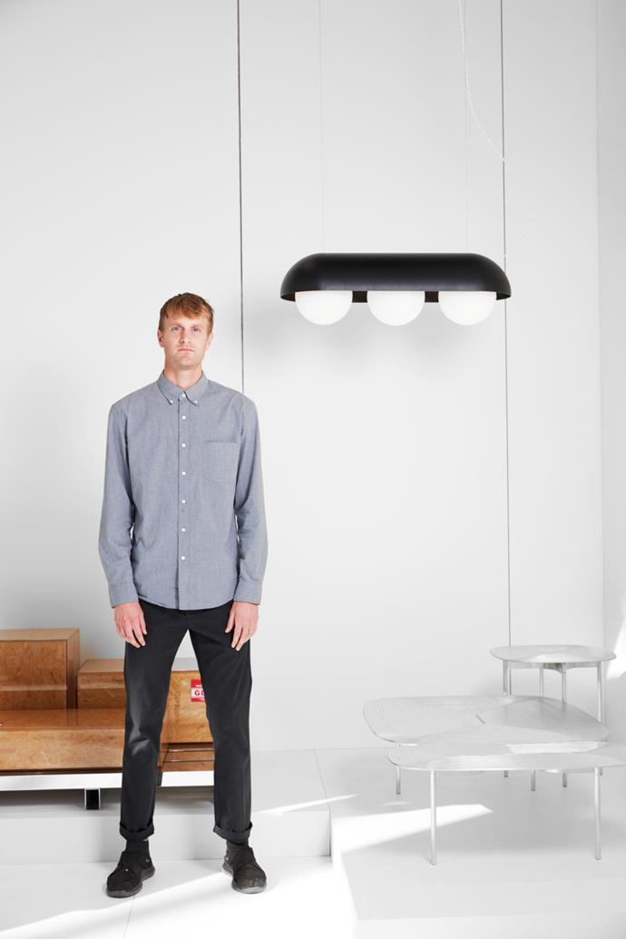 Alex Brokamp pictured with his 'Peapod' light and 'Collate' table