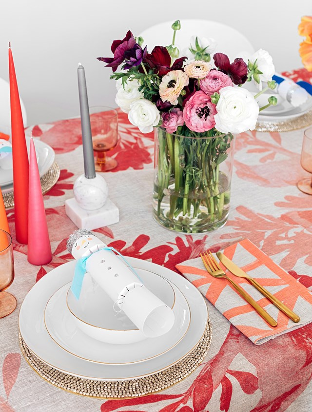 For a modern Christmas table setting that breaks all the rules, channel this eclectic and colourful spread. Eschew traditional colours and novelty decorations in favour of rich, jewel-toned accessories, crystal glassware and bright blooms.