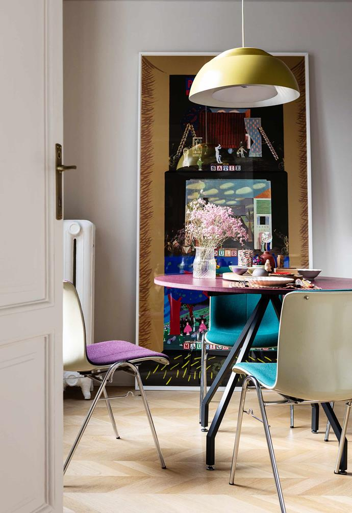 **Eat-in kitchen** Each of the coloured Side Chairs is by Sori Yanagi for Kotobuki. Table, Danese Milano. AJ Royal pendant lamp by Arne Jacobsen, through Cult.