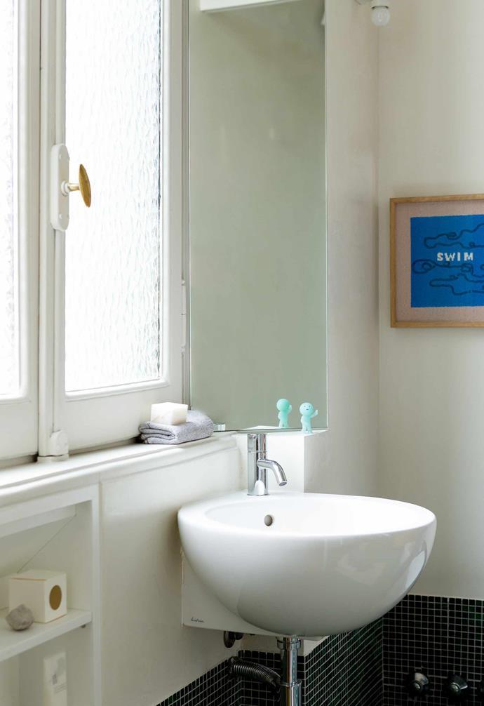 **Bathroom** An artwork designed for Nanban by illustrator Rose Blake hangs in the bathroom.
