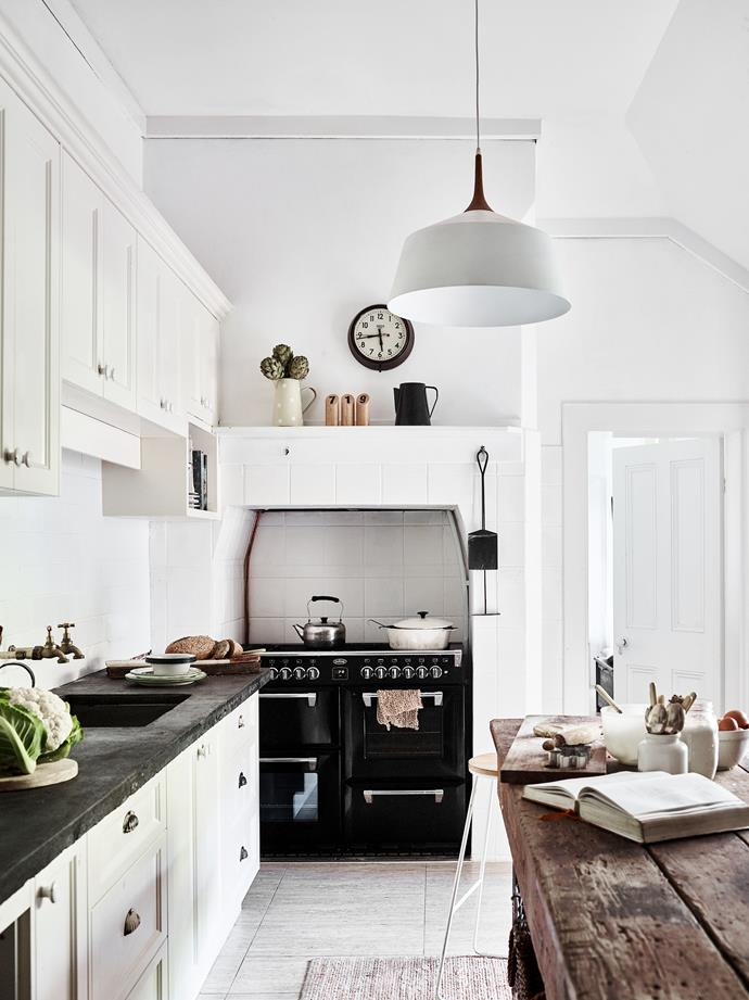 """The old kitchen workbench was found in Nether Hill's shed and Kate and Adrian formed the concrete benchtop """"in situ and poured it on a freezing cold night"""". The original stove was replaced by a Richmond dual fuel range cooker from Belling."""