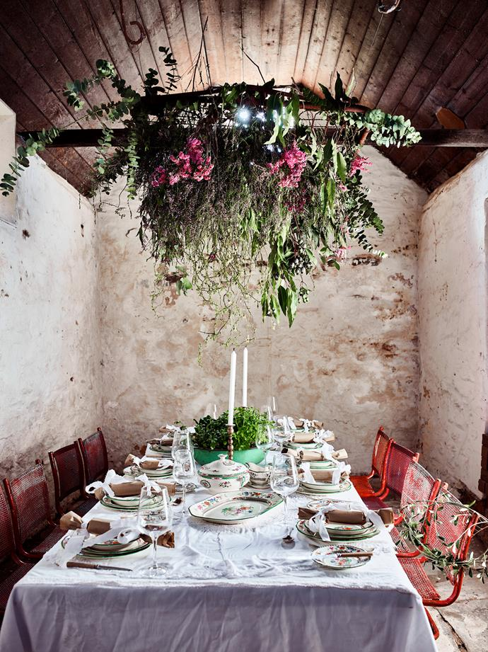 The creamery features lime-washed walls and flagstone floors, old tennis chairs from Gumtree, and a chandelier made from a gate from Cudlee Creek woven with flowers and foliage.