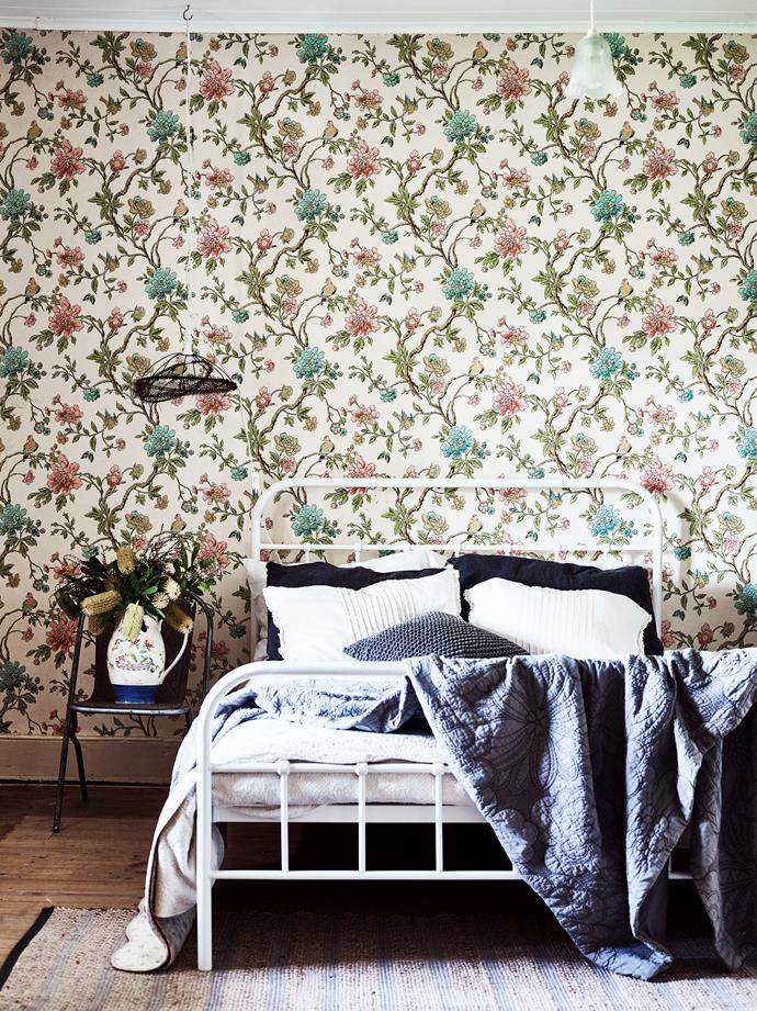 The circa-1970s wallpaper in the bedroom is original. The Wedgwood Sarah's Garden vase, sitting atop a Sebel chair from Gumtree, was a wedding gift.