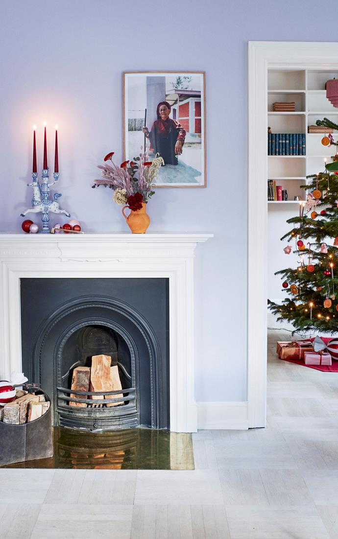"""The open fire is a gathering point during the Christmas period as it warms the home and provides a cosy atmosphere. The mantel is adorned with eclectic pieces like the vintage Bjørn Wiinblad candleholder, ceramic vase and an artwork from photographer Morten Nordstrøm. The [Christmas tree](https://www.homestolove.com.au/christmas-tree-decorating-tips-2611