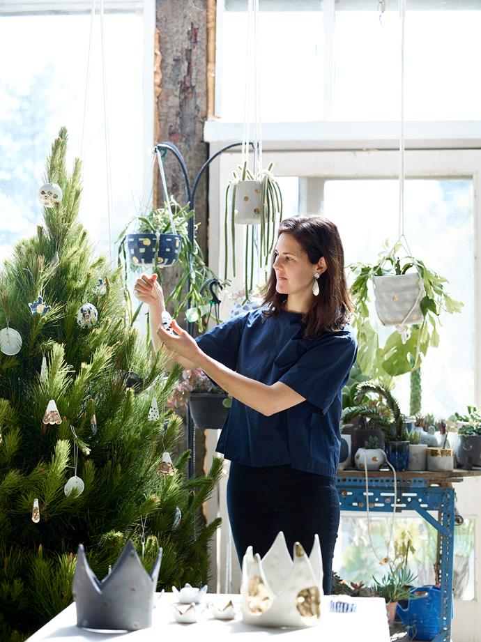 Bridget Bodenham decorating her Christmas tree at home near the town of Hepburn Springs, Victoria.