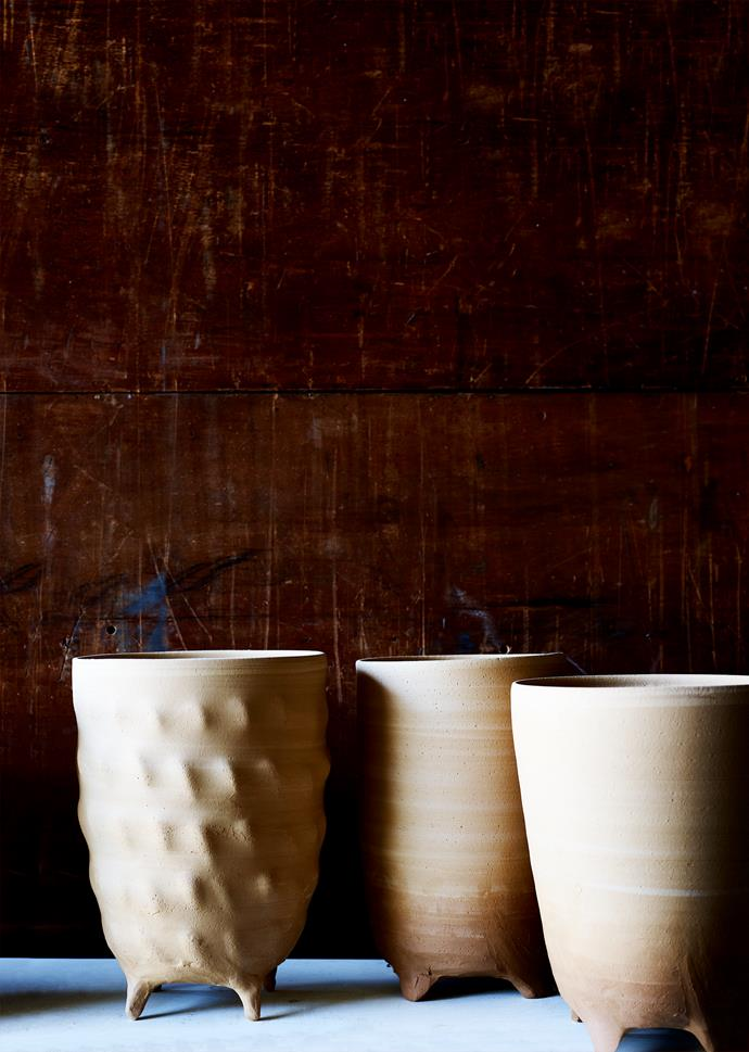 Unfired, hand-thrown vases left to dry.