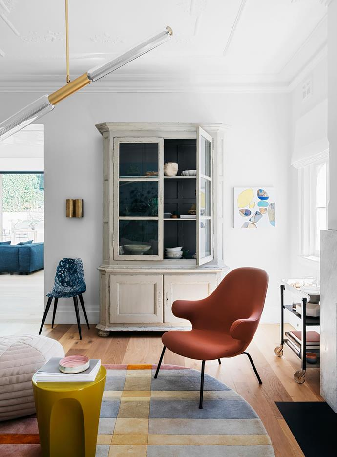 In the formal living room on a Baldwin & Bagnall rug from Nodi are an &Tradition 'Catch' chair from Great Dane, B&B Italia 'Colosseo' side table from Space and Fogia 'Poppy' ottoman. Pietro Russo Design 'Apollo' pendant light from Criteria. 'Precision' wall sconce by Kelly Wearstler. Edra 'Gina' chair from Space. Custom cabinet by Penman Brown. Artwork by Ari Athans.