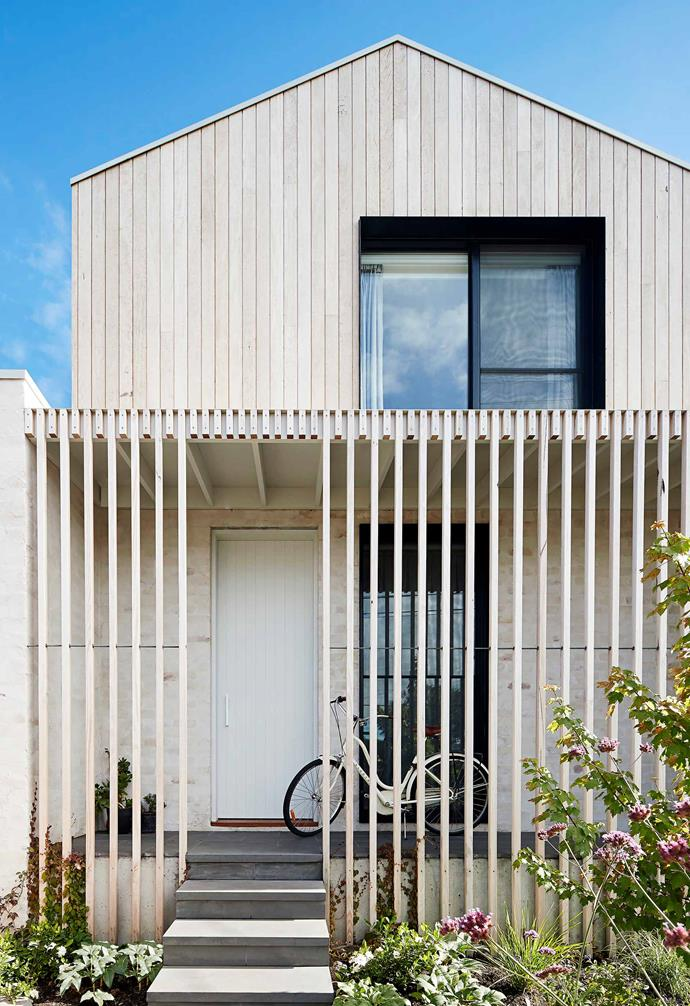 **Exterior** Blackbutt batons at the entrance of Rebecca and Rory's home will weather with age, as will the cladding. The recycled brick wall has been lightly bagged instead of rendered to subtly expose the tone of the bricks.