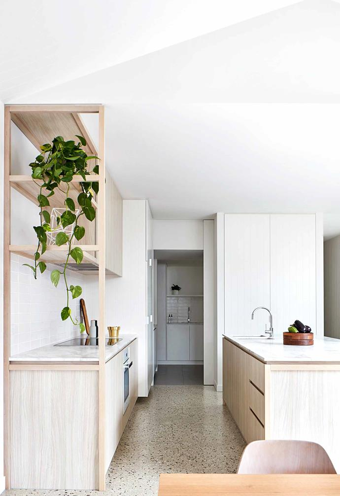 """**Kitchen** Polished concrete flooring with a high white aggregate mix grounds joinery in Soft Walnut ravine laminate from [Polytec](https://www.polytec.com.au/