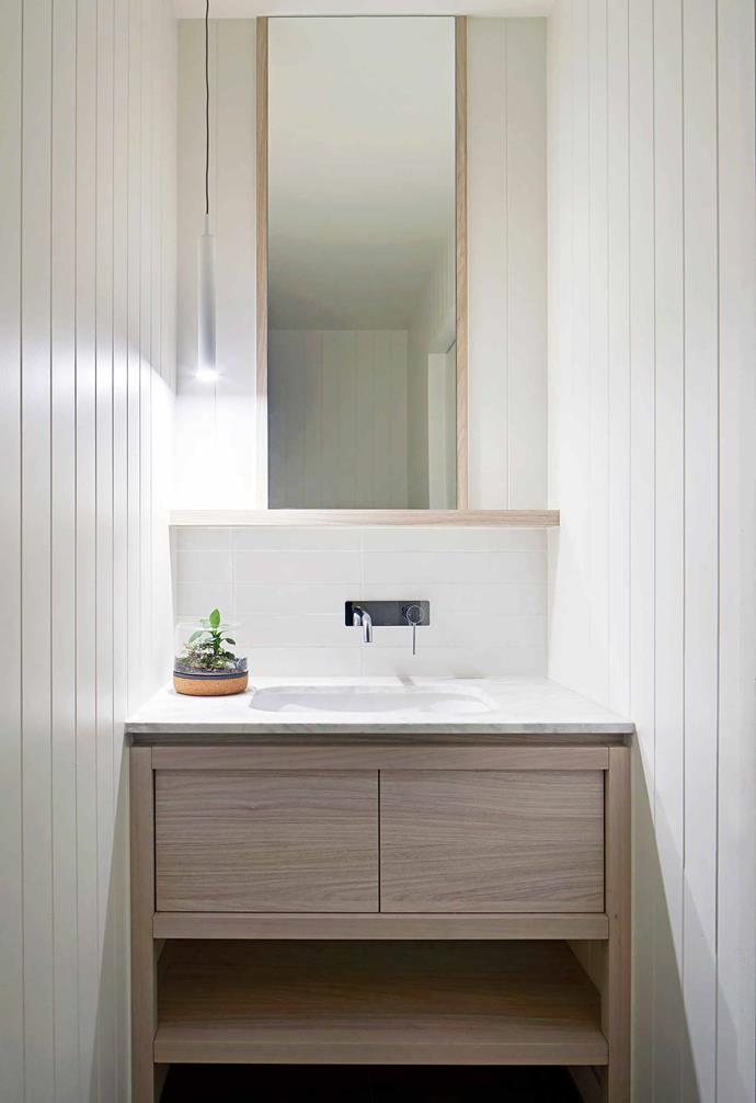 """**Powder room** """"There are two other bathrooms now,"""" says Rebecca, """"but we love the ground-floor powder room as it's concealed in the joinery near the study nook. You have to push the door to open it."""""""