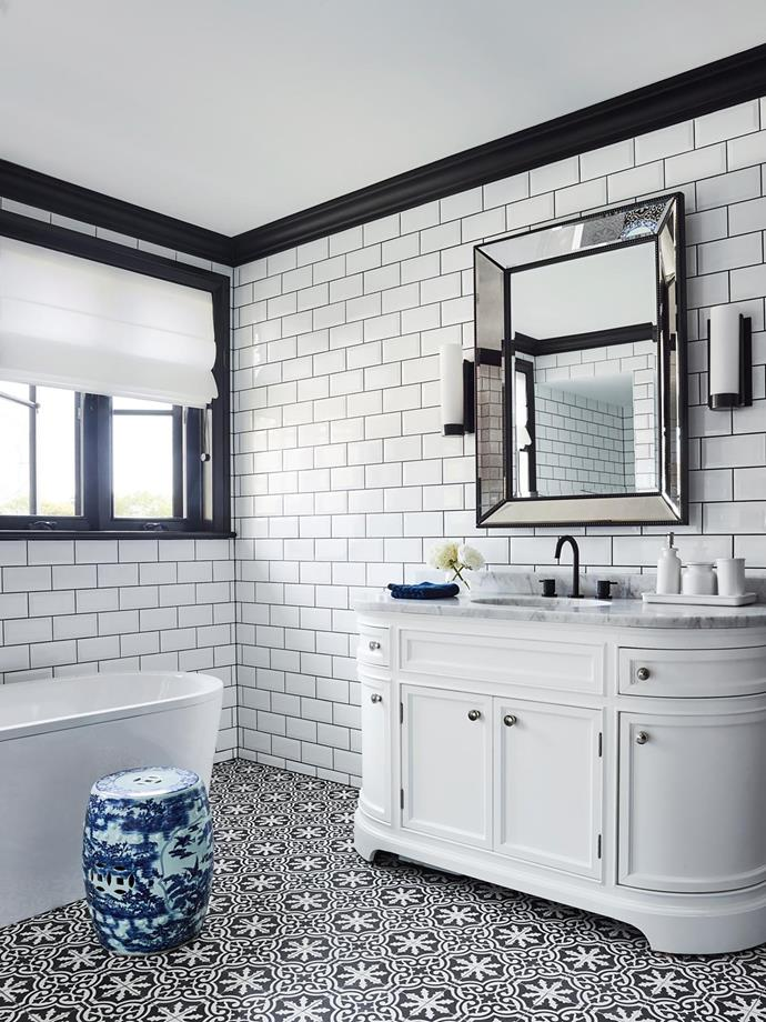 Vanity with Carrara marble top and mirror, both Restoration Hardware. Wall and floor tiles, Di Lorenzo Tiles. Kaldewei bath, Bathe. Tapware, Astra Walker. Existing drum stool.