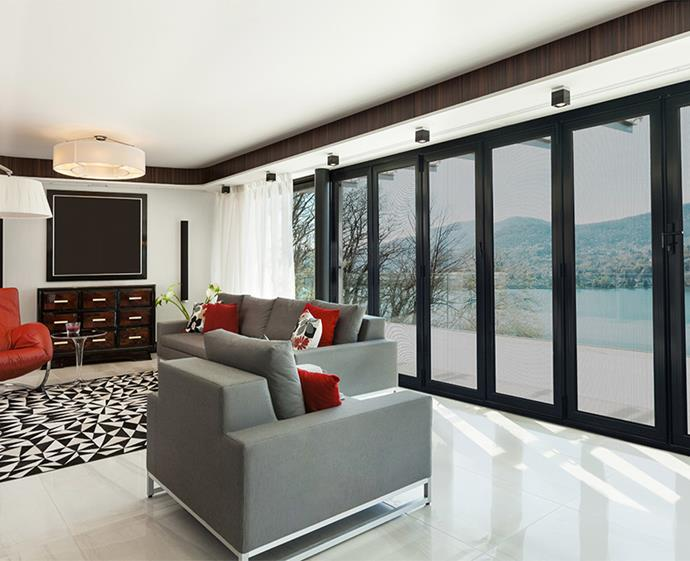 The Crimsafe Bi-fold doors by Wynstan work beautifully in this contemporary space, adding natural light and a versatile indoor-outdoor feel when opened.