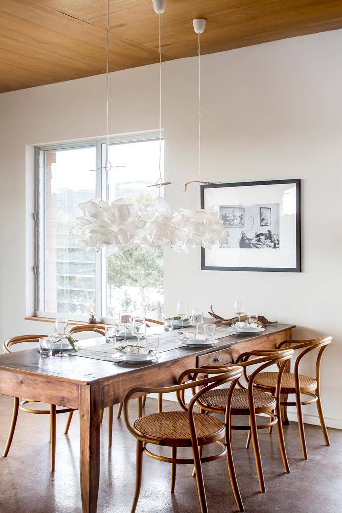 The dining area presents a communal setting and takes advantage of the views.