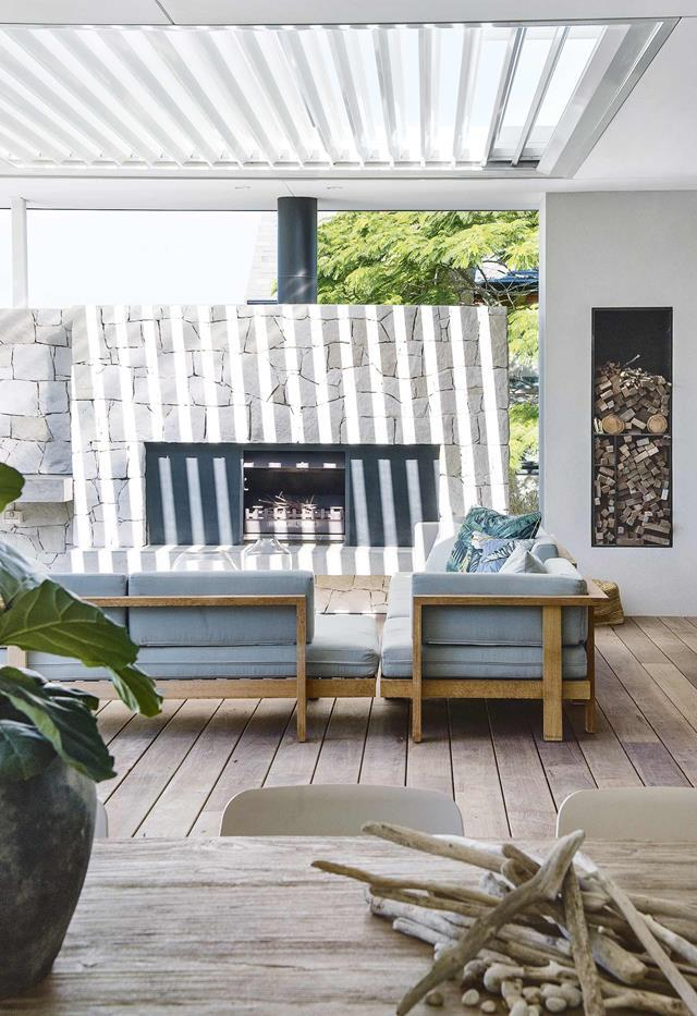 "With its north-facing aspect, the front of this house in beachside Cottesloe, Perth, becomes the ideal place to position an [alfresco living area](https://www.homestolove.com.au/outdoor-room-inspiration-19616|target=""_blank""). The raw materials that furnish the space reflect its location. The fireplace welcomes family and friends outside to wine, dine and relax, no matter the climate. It makes a cosy space all year round."