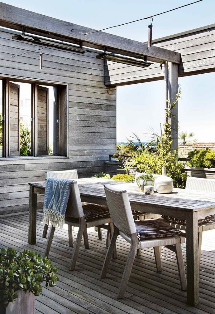 "This [seaside home's](https://www.homestolove.com.au/reverse-brick-veneer-house-18270|target=""_blank"") top level takes advantage of the location, with Aneeta sashless windows that don't distract from the coastal views. The spotted gum cladding brings a relaxed beach house feel while the woven back of an Eco Outdoor 'Hutt' sofa brings another texture into the mix."