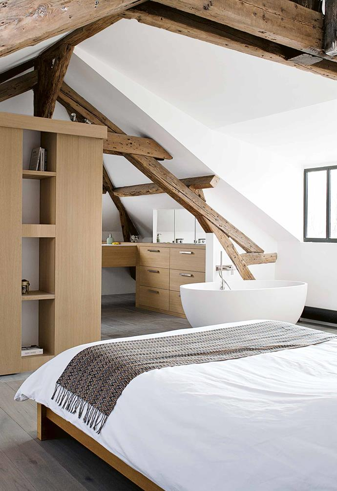 "This third-floor parents' retreat is part of a full renovation of a home about nine kilometres north west of the centre of Paris. The intention was to create a harmonious place for family life. The former attic space now houses a large [master bedroom](https://www.homestolove.com.au/modern-bedroom-ideas-18706|target=""_blank"") complete with dressing room and [ensuite bathroom](https://www.homestolove.com.au/ensuite-bathroom-design-ideas-18820