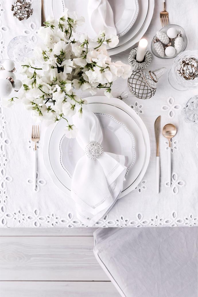 Keep things classic and elegant with an all-white tablescape this Christmas. Layers of white table linen, dinnerware and decorations can be kept interesting by adding different textures and metallic  accents for added luxury.